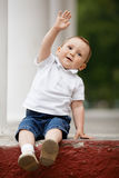 Boy with hand raised Royalty Free Stock Photos