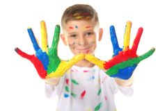 Cute little boy with hands and face in paint. On white background Royalty Free Stock Photos