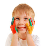 Cute little boy with hands in paint Royalty Free Stock Photography