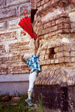 Cute little boy hangs red umbrella Royalty Free Stock Image