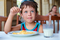 Cute little boy having delicious breakfast Royalty Free Stock Image