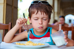 Cute little boy having delicious breakfast Stock Photos