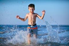 Cute little boy having fun at the beach stock photo