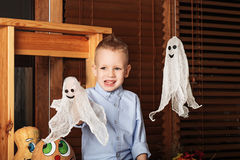 Cute Little Boy having fun in Halloween decorations Stock Images