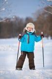 Cute little boy having fun during skiing on cross Royalty Free Stock Image
