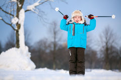 Cute little boy having fun during skiing on cross Royalty Free Stock Photos