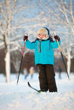 Cute little boy having fun during skiing on cross Royalty Free Stock Image