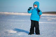 Cute little boy having fun on winter beach Stock Photography