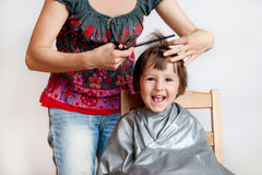 Cute little boy, having haircut, smiling happily Royalty Free Stock Photography