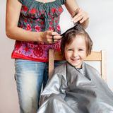 Cute little boy, having haircut, smiling happily Stock Photography