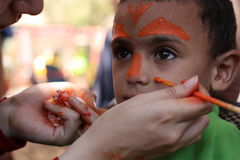 Cute Little boy having his face painted Kids having fun playing Royalty Free Stock Photography