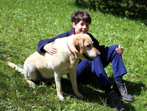 Cute little boy with his dog Stock Image