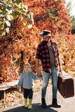 Cute little boy with his father during stroll in the forest. Father and son walking together in the park, fall day. Cute little boy with his father during stock images