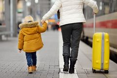 Cute little boy and his grandmother/mother on railway station platform Royalty Free Stock Photography