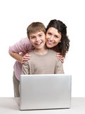 Cute little boy and his mother with a laptop Royalty Free Stock Photos
