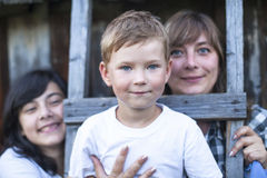 Cute little boy with his mother and older sister Royalty Free Stock Images