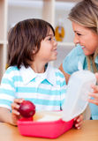 Cute little boy and his mother preparing his snack Royalty Free Stock Photo