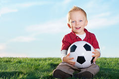Cute Little Boy and his soccer ball Royalty Free Stock Photo