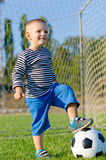 Cute little boy and his soccer ball Stock Images