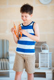 Cute little boy holding big prawn in hands Royalty Free Stock Images