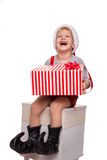 Cute little boy holding big present and laugh. Christmas concept Royalty Free Stock Images
