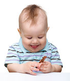 Cute little boy is holding chocolate bar and smile Stock Images