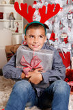 Cute little boy holding a Christmas gift Stock Image