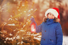 Cute little boy holding Christmas lantern outdoors on winter snow day. Cute little boy holding Christmas lantern outdoors on beautiful winter snow day Stock Photos