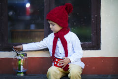 Cute little boy, holding cup with tea, waiting for Santa Stock Image
