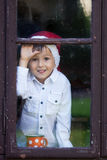 Cute little boy, holding cup with tea, waiting for Santa Royalty Free Stock Images