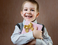 Cute little boy holding dotted present boy Stock Image