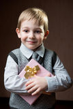 Cute little boy holding dotted present boy Royalty Free Stock Photo