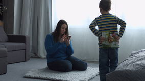 Little boy giving present to her mom on Mother`s day stock video footage