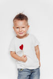 Cute little boy holding heart shape on stick Royalty Free Stock Photography