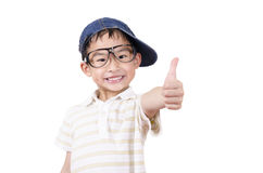 Cute little boy holding his thumb up Royalty Free Stock Photos