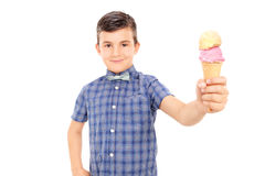 Cute little boy holding an ice cream Stock Photo