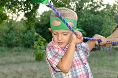 Cute little boy holding onto a purple rope Royalty Free Stock Photo