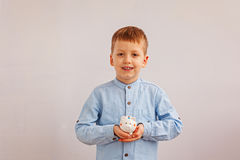 Cute little boy holding a piggy bank or money box. Royalty Free Stock Images