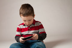 Boy playing video game Stock Photography