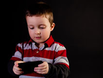 Boy playing video game Royalty Free Stock Photography