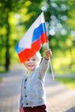 Cute little boy holding russian flag Stock Photo