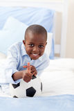 Cute little boy holding a soccer ball Royalty Free Stock Photography