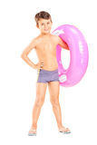 Cute little boy holding a swim ring. Full length portrait of a cute little boy holding a swim ring isolated on white background Royalty Free Stock Image
