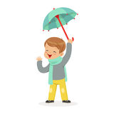 Cute little boy holding umbrella playing in the rain cartoon vector Illustration Stock Photo