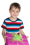 Cute little boy holds a gift box Stock Photo