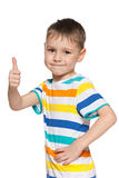 Cute little boy holds his thumb up Stock Photos