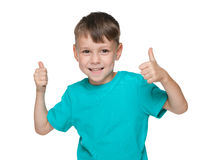 Cute little boy holds his thumbs up Stock Image