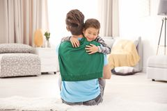 Cute little boy hugging his father. At home Royalty Free Stock Photos