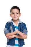 Cute little boy imagines. A cute little boy imagines the white background stock images