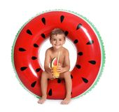 Cute little boy with inflatable ring and glass. Of cocktail on white background stock photography